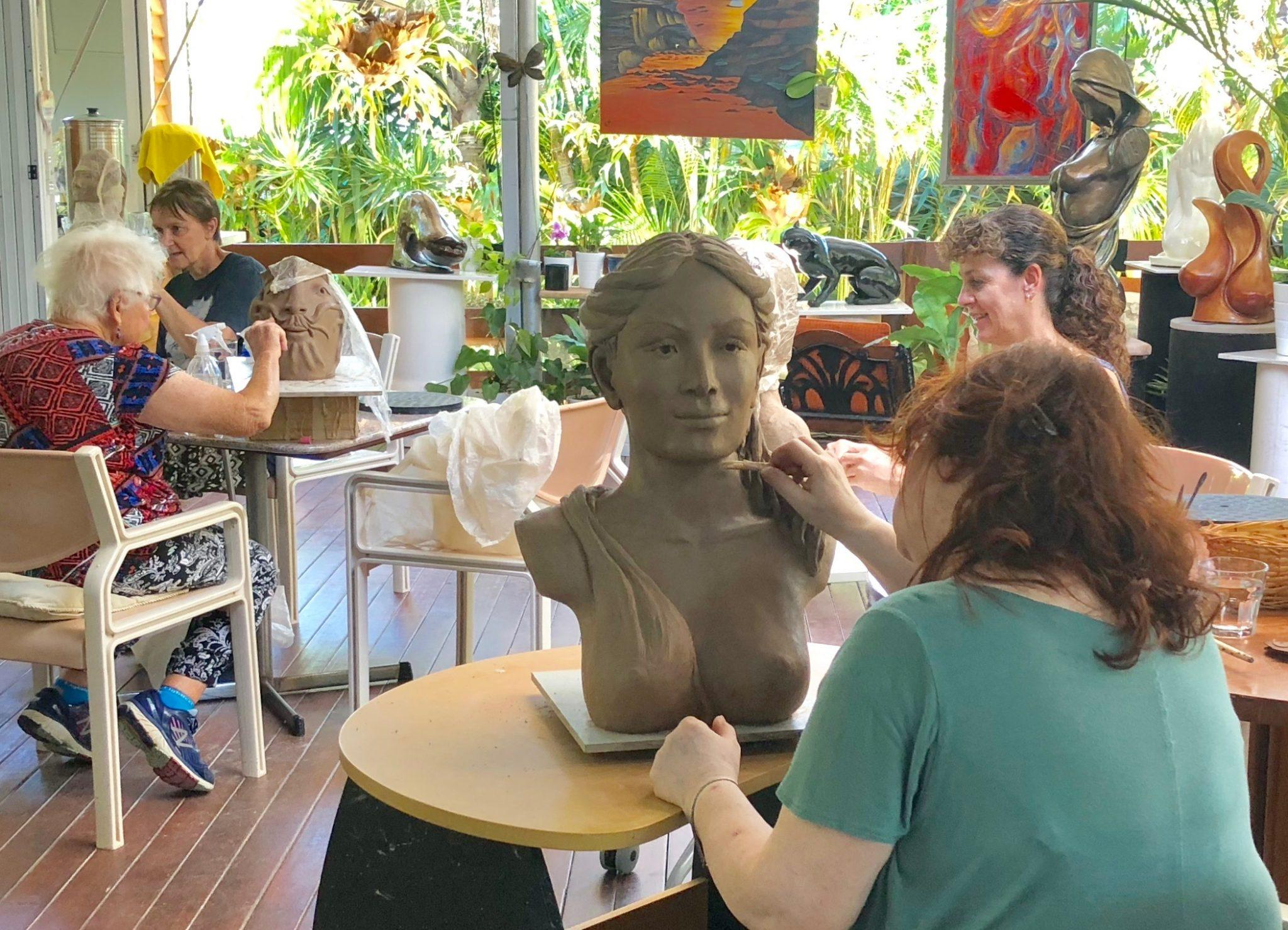 Paulina is now detailing her sculpture before it gets fired.