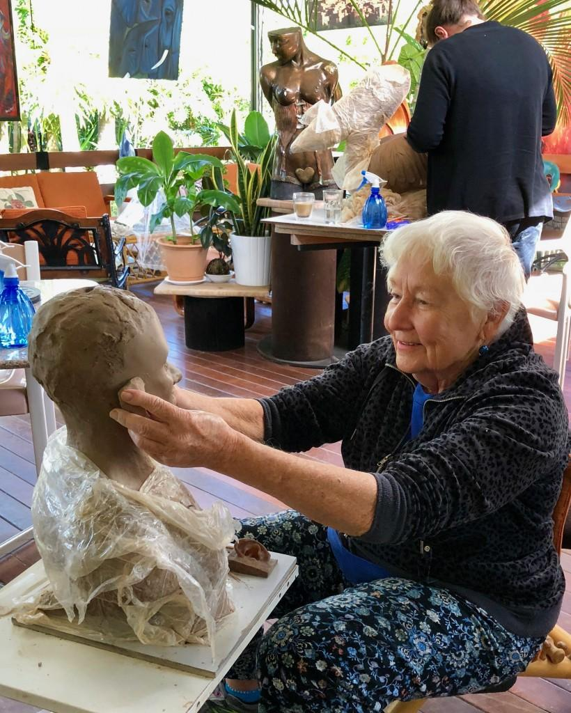 Alison enjoying sculpting her new male sculpture in class