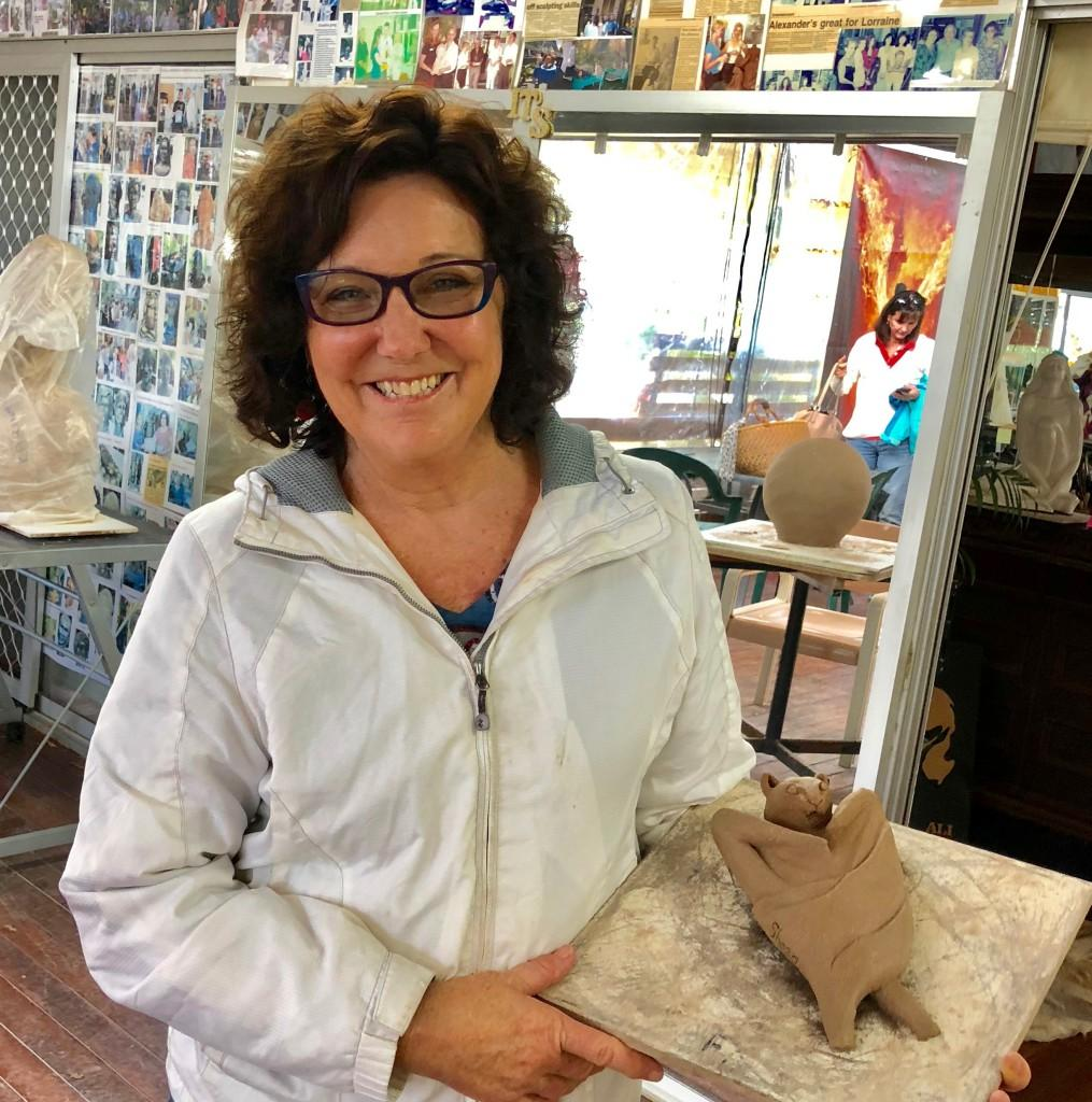 Art class, in sculpting, not pottery, where  Sheryl finished yet an other cute sculpture