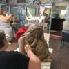 Social distancing during the clay art sculpturing class