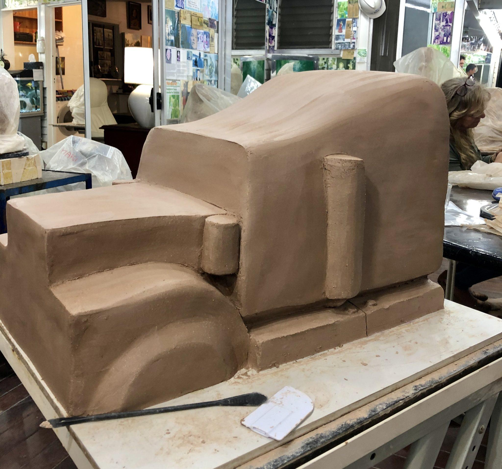 Lee's clay sculpture is progressing during the art class