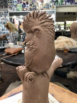Black Clay parrot progressing during the art class